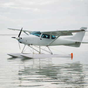 The seaplane is on the surface of the water. Mauritius